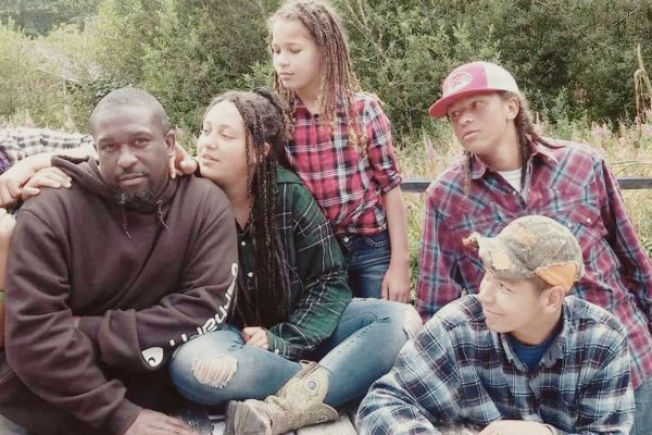 Sugar Hill Owner Michael Hill Sits with his Children