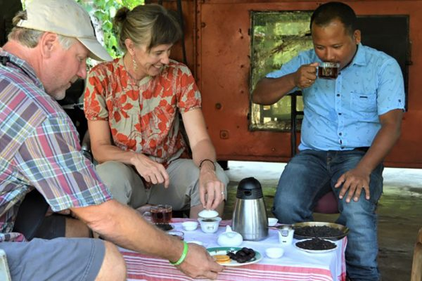 Lake Missoula Tea Co. | Owners Heather and Jake Kreilick comparing two black teas (Bodo Black and Dom Dom Assam) at an Elephant Friendly Tea certified farm